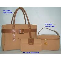 Handbag with vanity and cosmetic bag